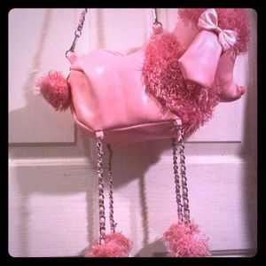 Dolls kill pink poodle purse say that 3x fast!